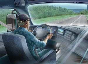 Lorry driver with sat nav on open road
