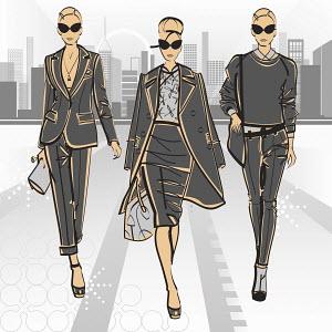 Three elegant fashion model businesswomen side by side approaching camera