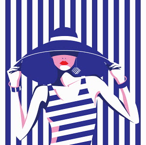 Fashion model in wide brimmed hat and blue and white striped pattern