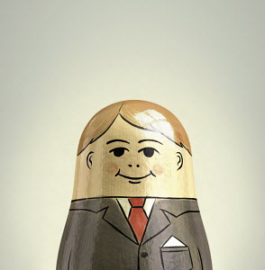Happy, smiling businessman nesting doll