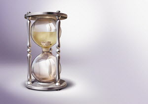 Stopping sands of time in hourglass with cork