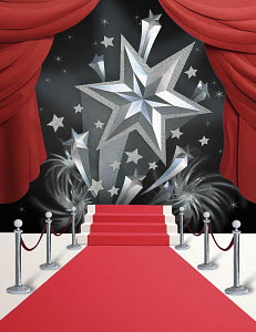 Papercut image of silver shooting stars rising above the red carpet with red theatre curtains. Paper art illustration by Gail Armstrong