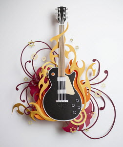 Stars and swirls surrounding paper craft guitar