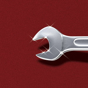 Shiny metal crescent wrench on red background