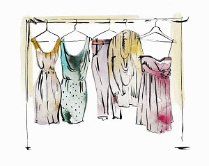 Women's clothing hanging on coathangers on clothes rail