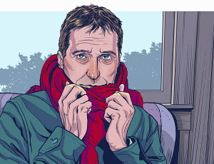 Man feeling cold sitting indoors wrapped in scarf