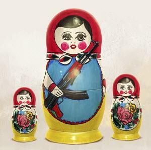 Russian nesting dolls nervously watching large doll holding machine gun