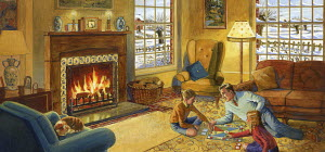 Father playing board game with children on floor in front of fire in cozy lounge