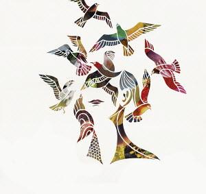 Birds flying around woman's head