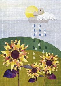 Raindrops falling on flowers growing in field