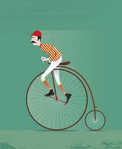 Old-fashioned cyclist on penny farthing bike