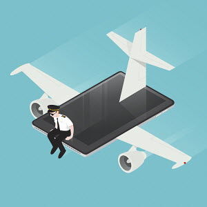 Airline pilot flying computer tablet airplane