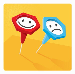 Contrasting indicator push pins with happy and sad smiley faces