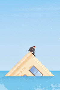 Businessman sitting on sinking company headquarters building