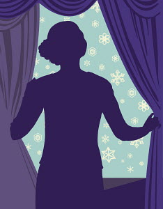 Woman looking at snow out window