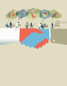 Handshake under scientists at work