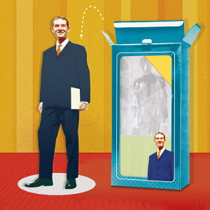 Businessman doll being removed from packaging