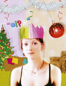 Sad woman in paper crown at Christmas