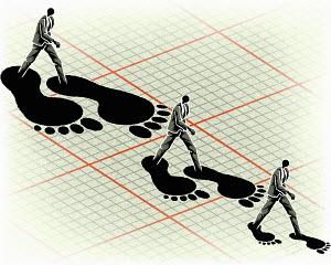 Businessman walking in large footprints