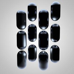 Group of shiny black capsules