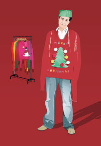 Unhappy man wearing large Christmas sweater