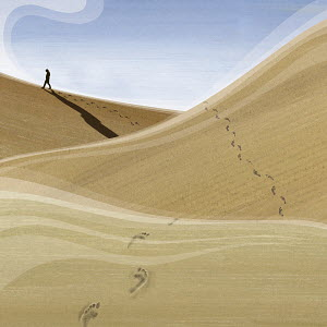 Man walking through desert