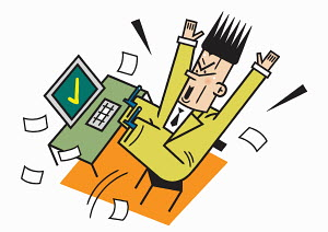 Businessman celebrating with arms raised at desk
