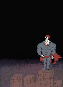 Businessman superhero on highrise building