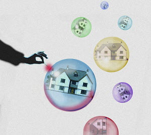 Hand pricking needle into house bubble