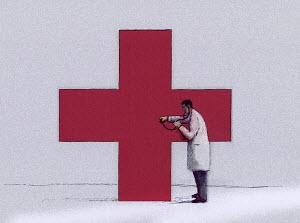 Doctor examining Red Cross