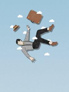 Businessman falling through the air