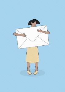 Woman hugging large envelope