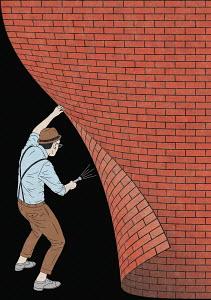 Man shining torch behind brick wall