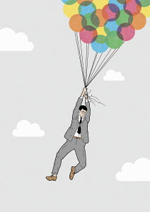 Businessman lifted into sky by bunch of balloons