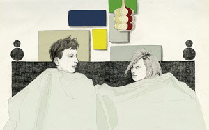 Young couple in bed facing each other