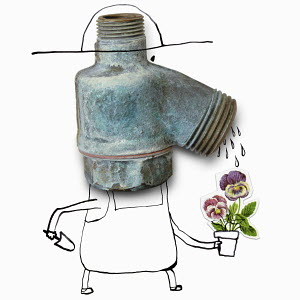 Gardener with faucet head watering flower
