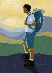Hiker with backpack looking at view