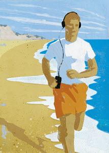 Man with headphones running on beach