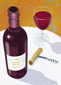 Glass and bottle of red wine and corkscrew on table