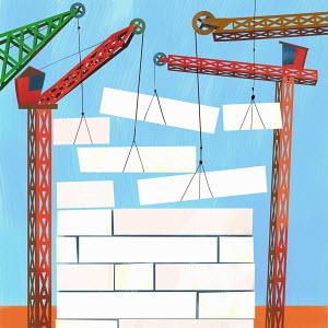 Cranes building up wall