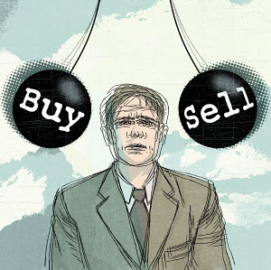 Businessman amidst buy and sell balls