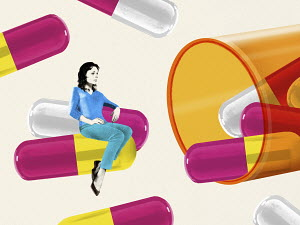 Woman sitting on large capsule