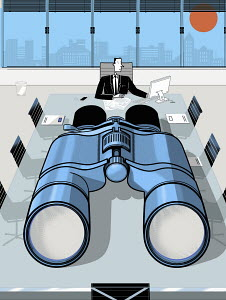 Businessman in conference room with large binoculars on table