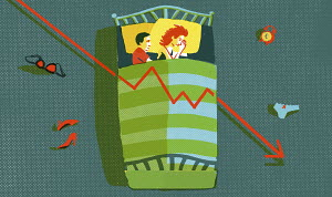 Couple lying in bed with decreasing line graph