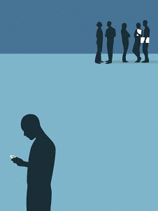 Silhouette of man with cell phone standing isolated from group of people