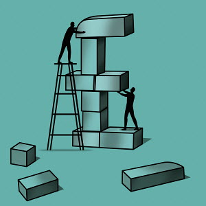 Silhouette of two men stacking blocks