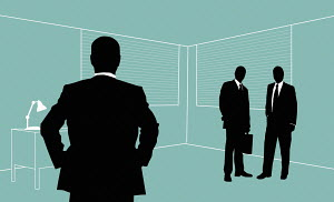 Two businessmen looking at colleague standing isolated