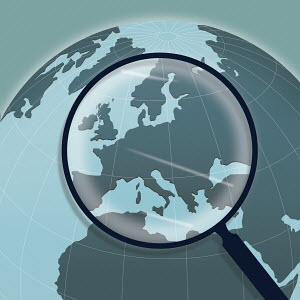 Magnifying glass above Europe on globe