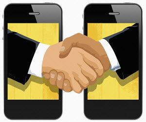 Two businessmen shaking hands in cell phone displays