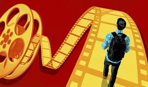 Teenager walking on film strip
